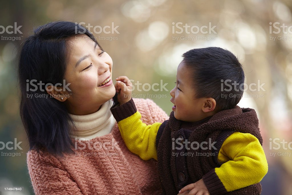 little boy playing with his mother royalty-free stock photo