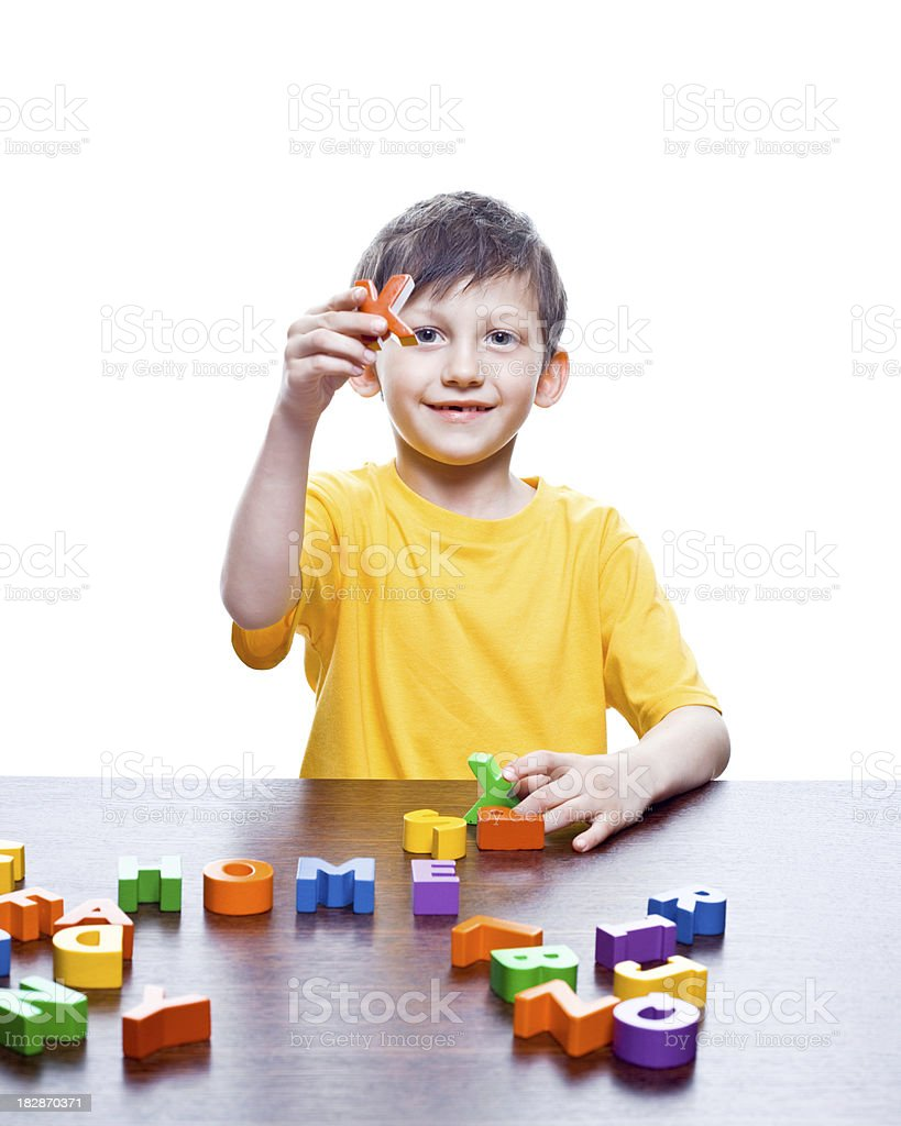 Little boy playing with letters royalty-free stock photo