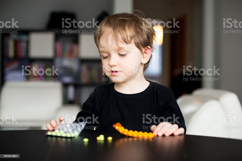 Little boy playing with medicines royalty-free stock photo