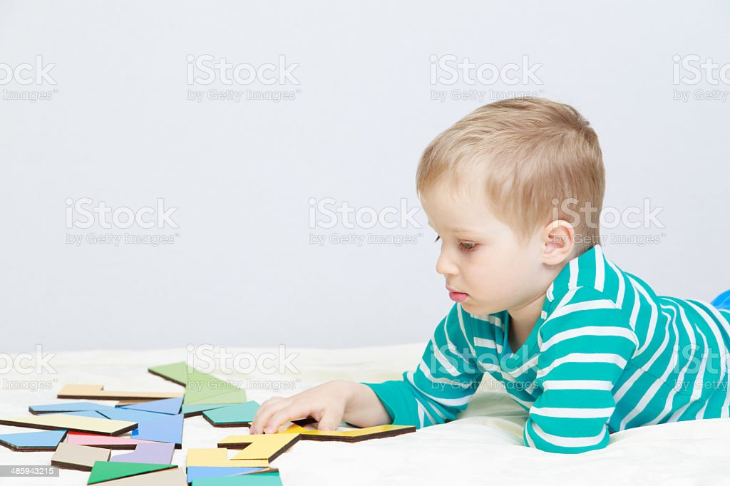 little boy playing with puzzle royalty-free stock photo