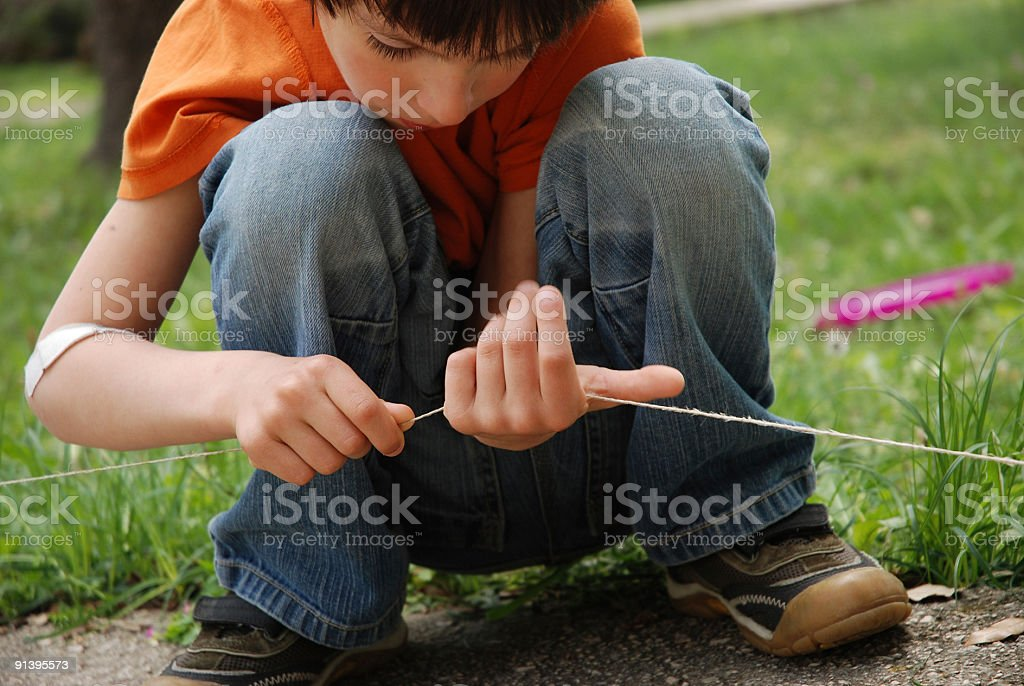 Little boy playing with string royalty-free stock photo