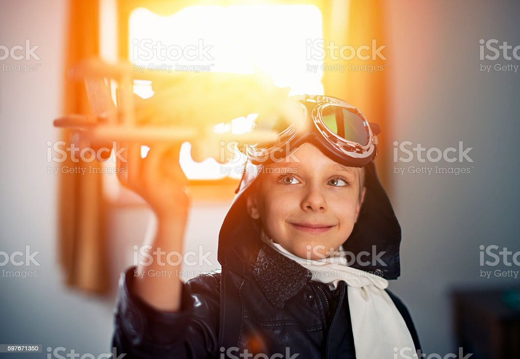Little boy playing with toy plane stock photo