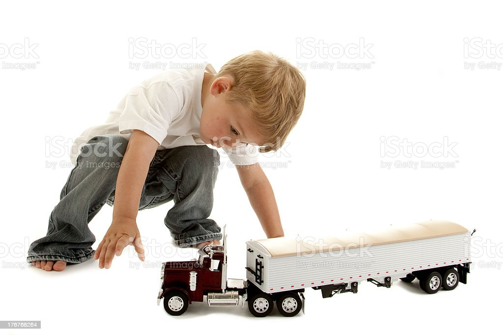 Little Boy Playing with Toy Truck stock photo