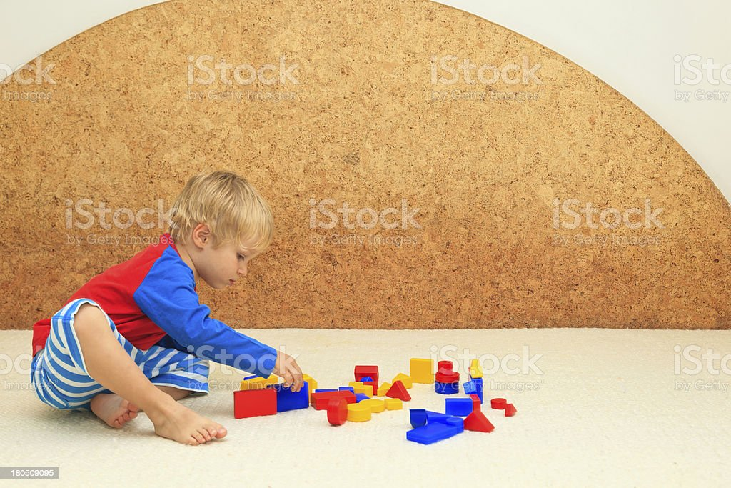 little boy playing with toys, learning and daycare concept royalty-free stock photo