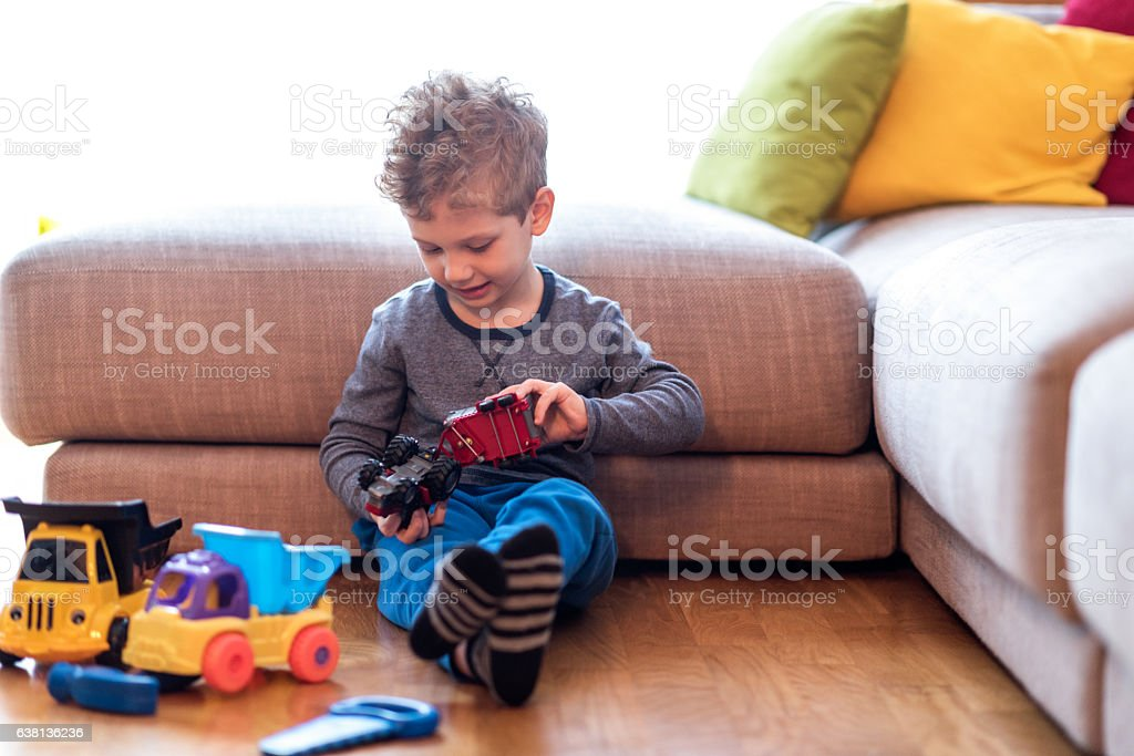 Little boy playing with toys stock photo