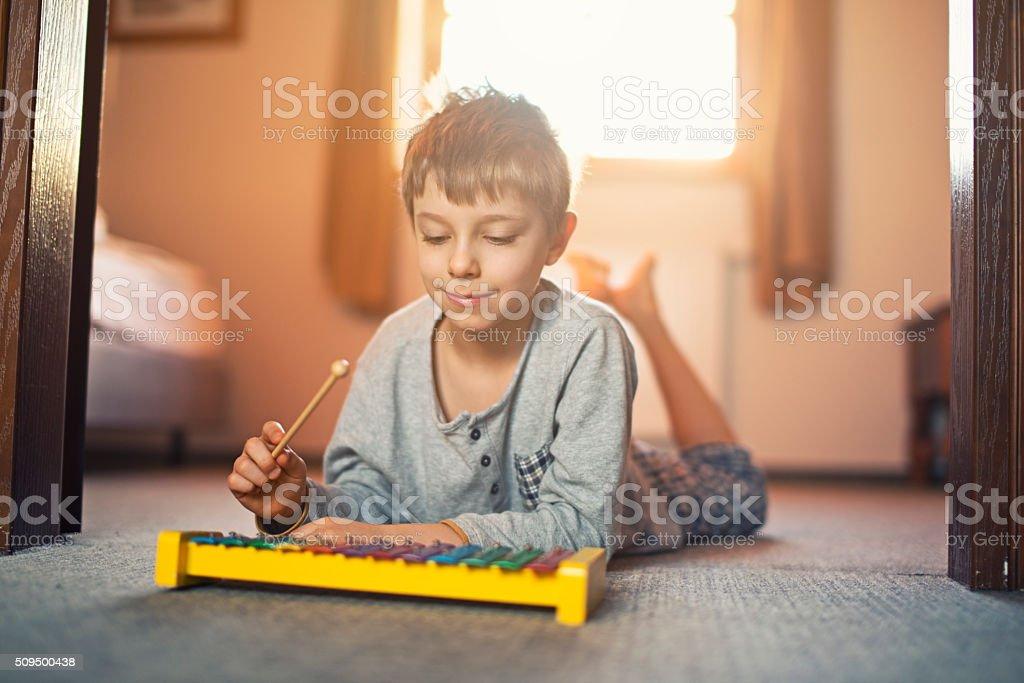 Little boy playing xylophone stock photo