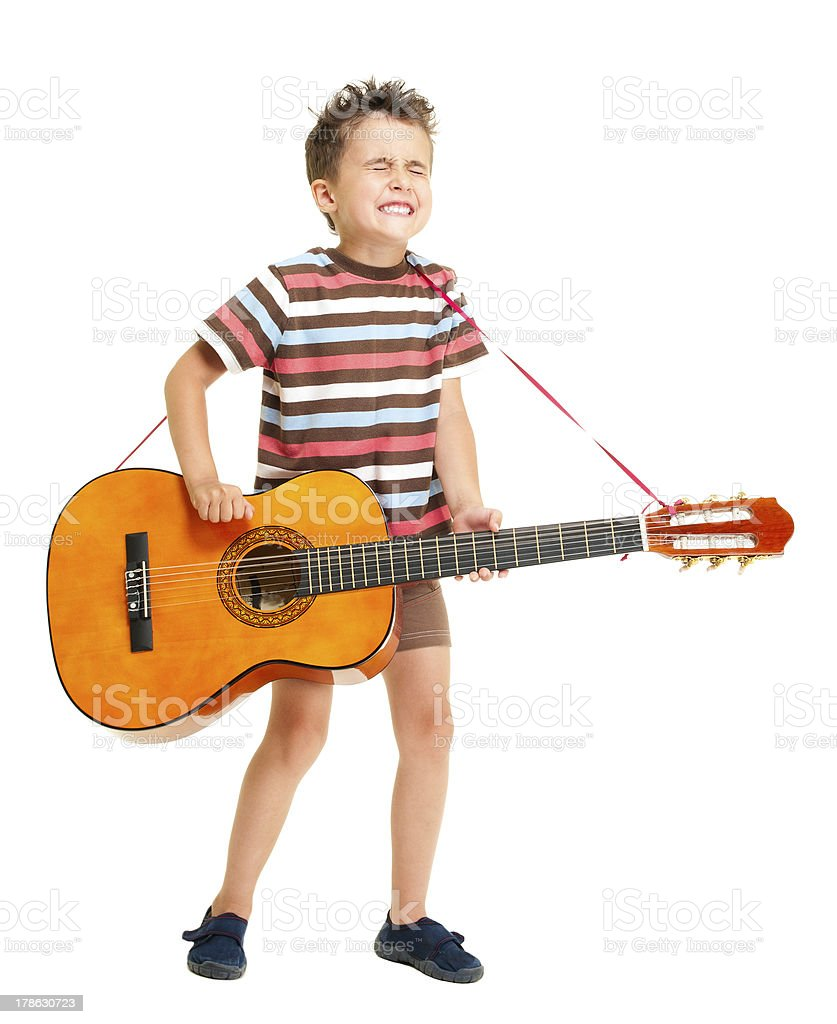 Little boy plays guitar country style stock photo