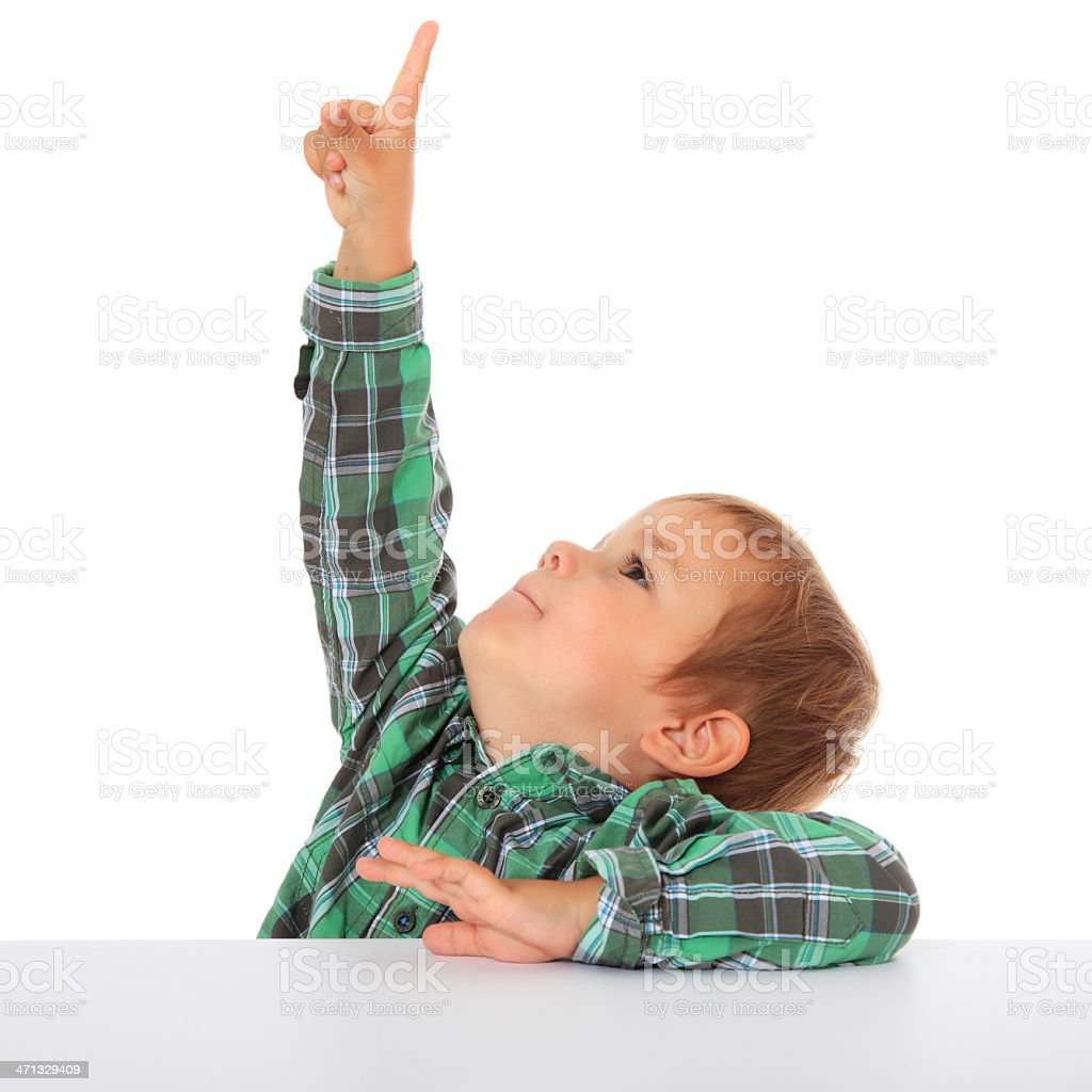 Little boy points with finger royalty-free stock photo