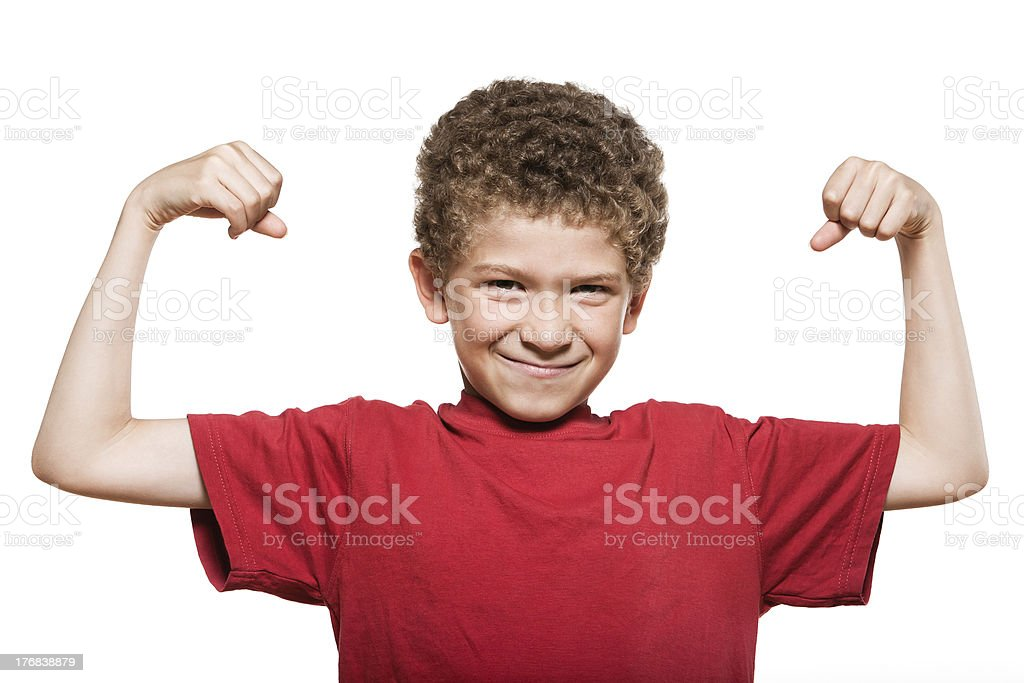 Little boy portrait strong flexing muscle biceps stock photo