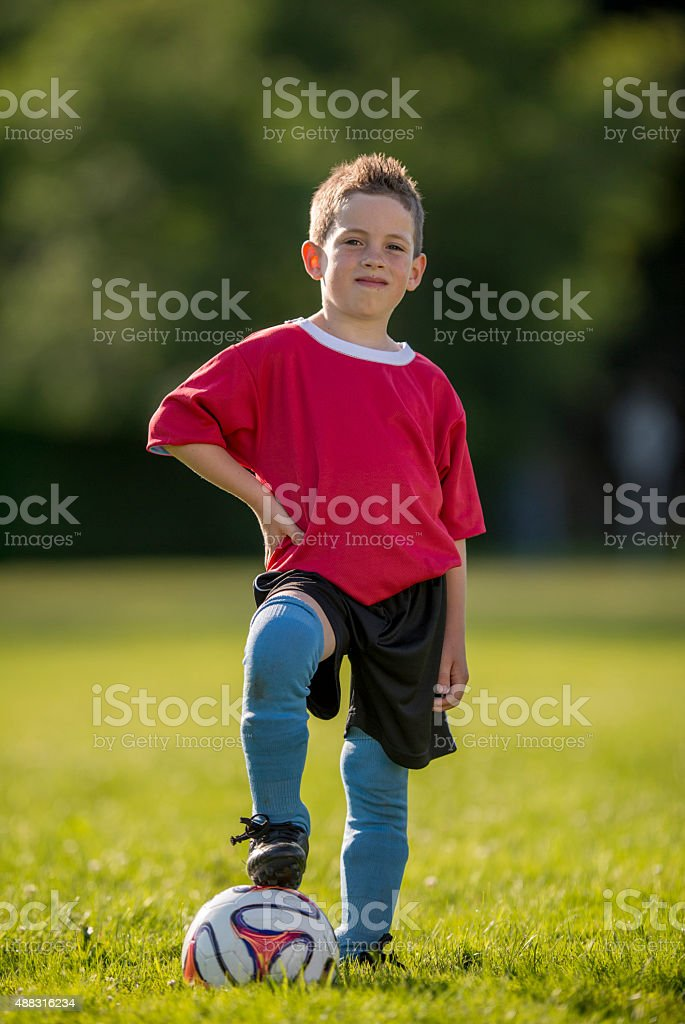 Little Boy Posing on Soccer Field stock photo