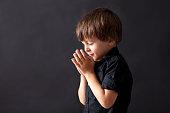 Little boy praying, child praying, isolated background