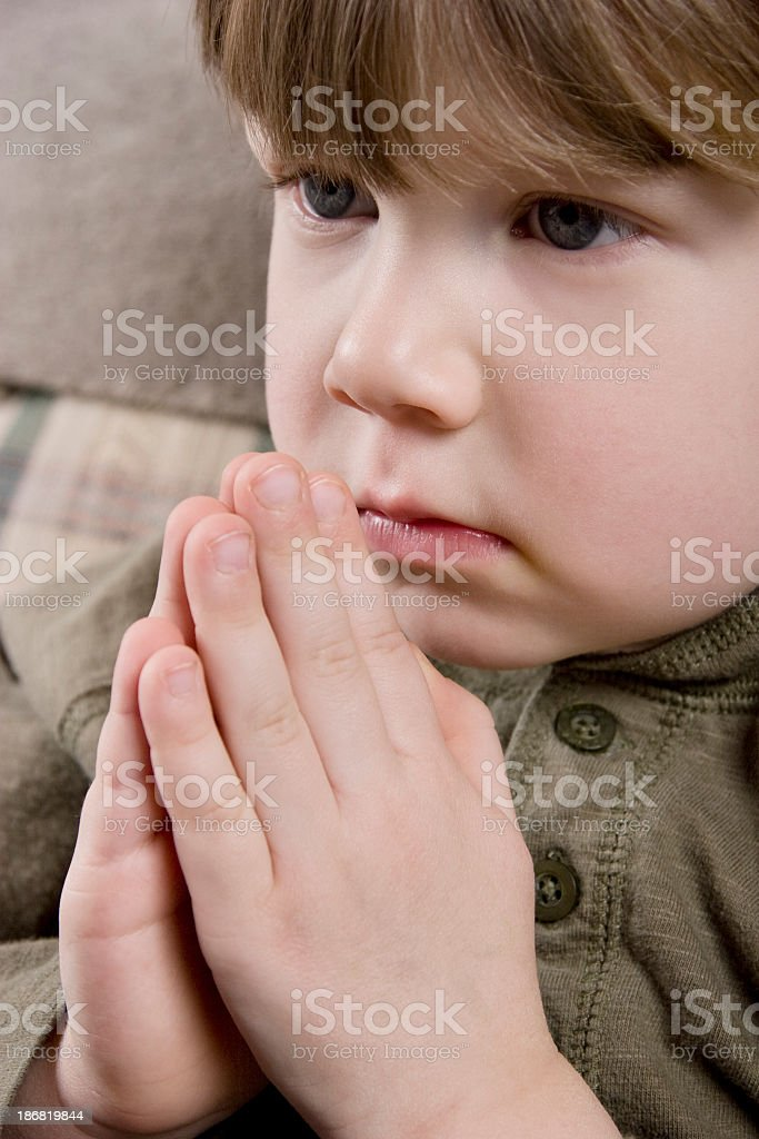 Little Boy Praying royalty-free stock photo
