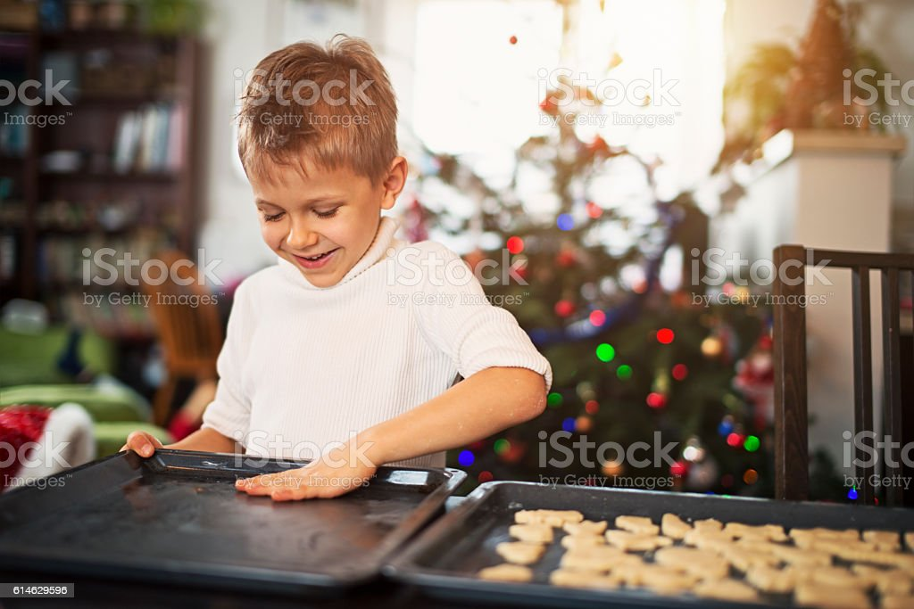 Little boy preparing christmas cookies stock photo