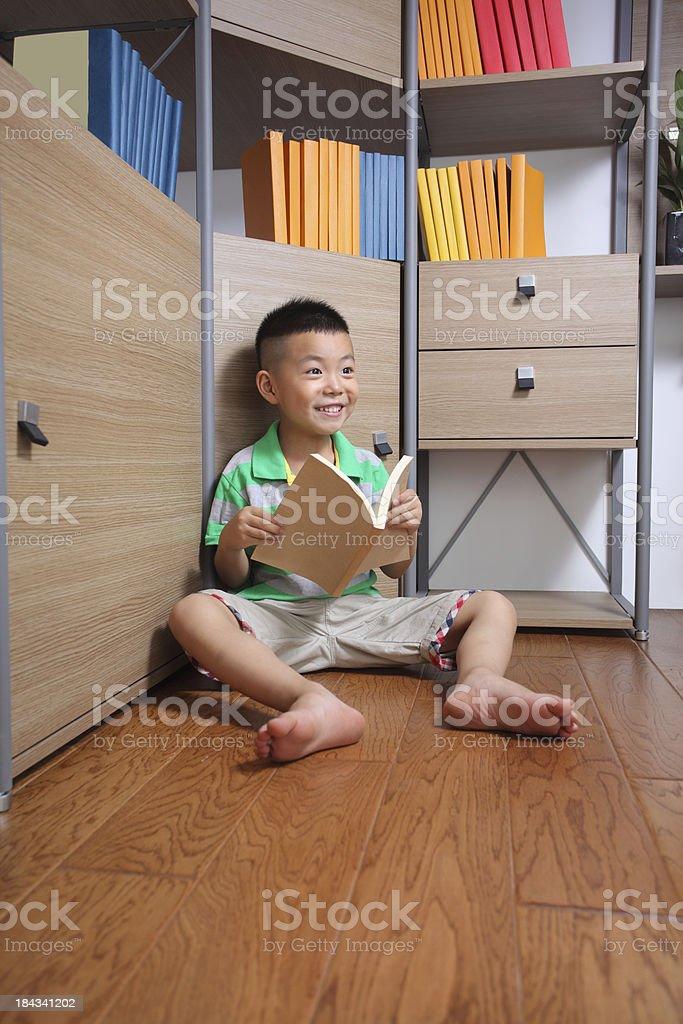 Little boy reading book royalty-free stock photo