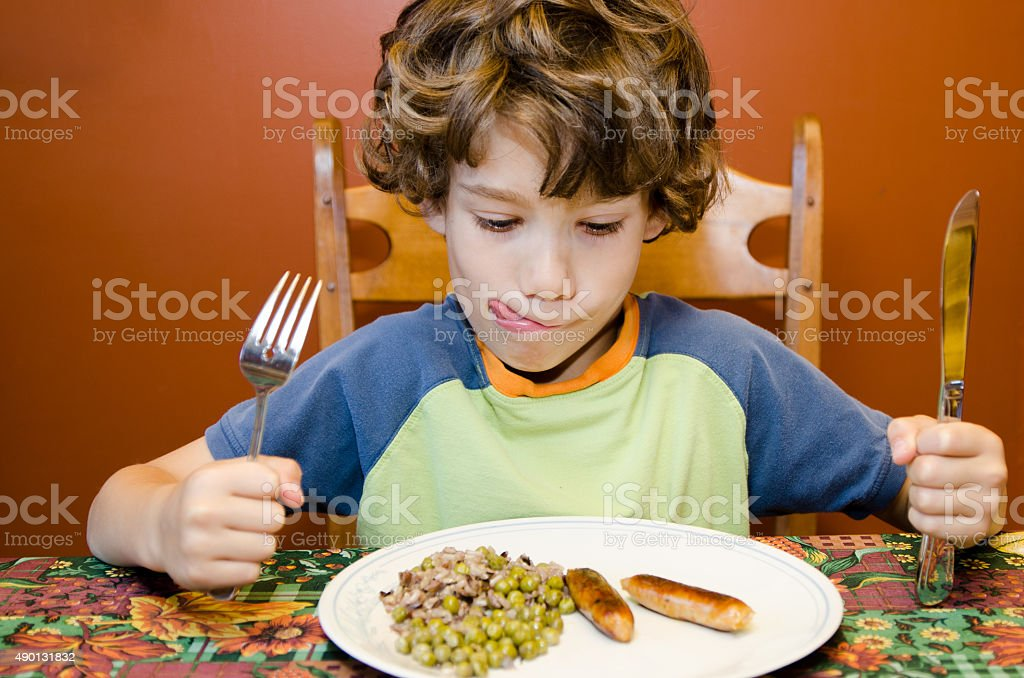 Little boy ready and happy to eat stock photo