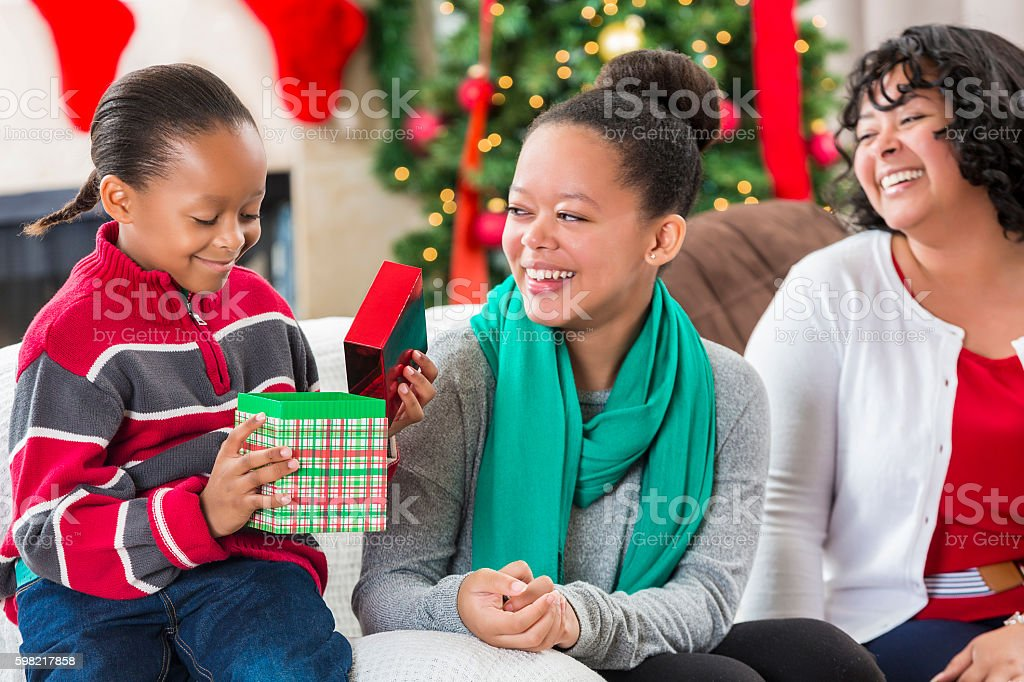 Little boy receives gift from sister stock photo