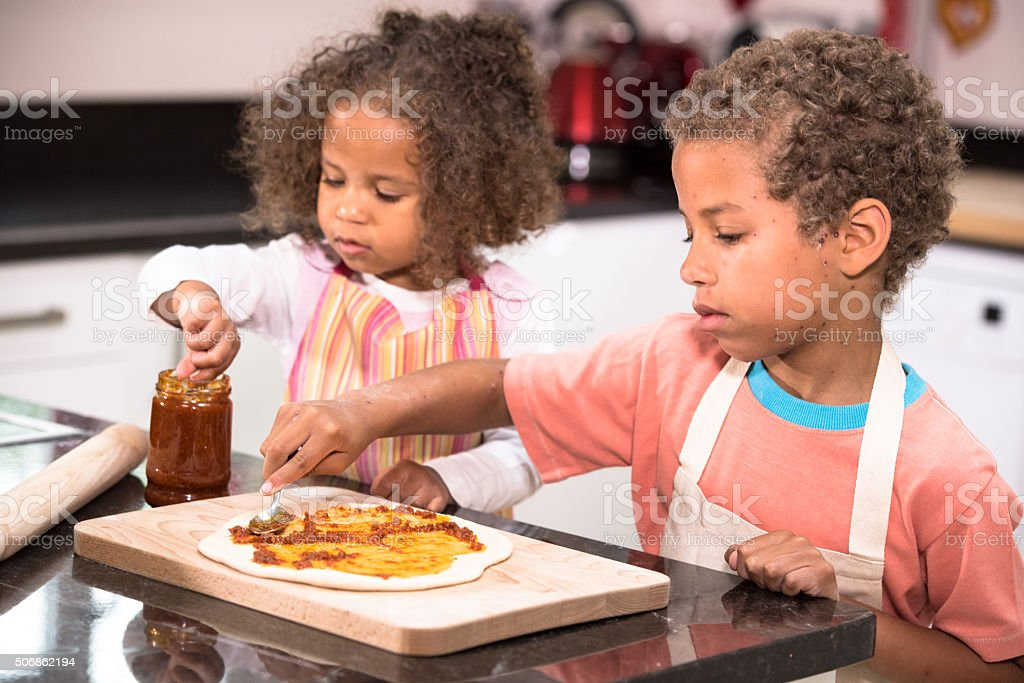 Little Boy Recovering From Chickenpox Making Pizza stock photo
