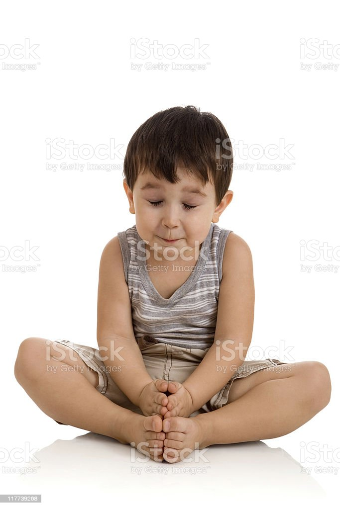 little boy relaxing on white background stock photo