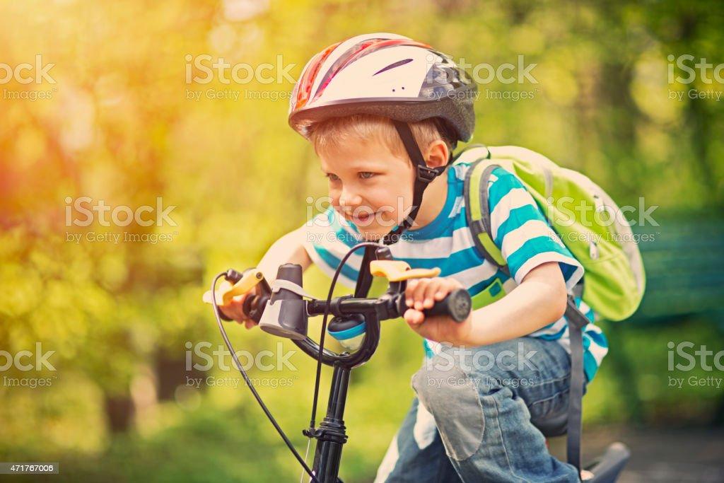 Little boy riding a bike stock photo