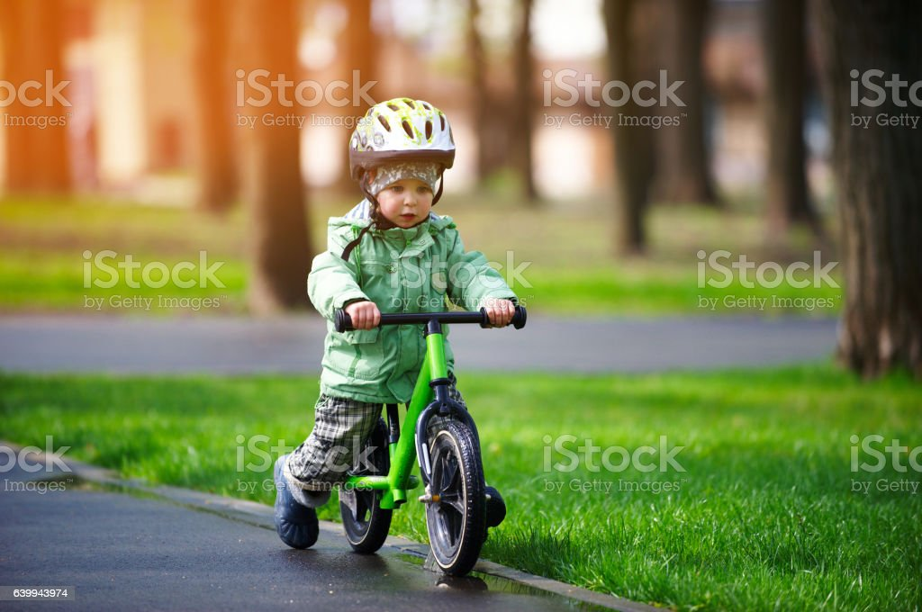 little boy riding a runbike stock photo