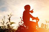 little boy riding bike at sunset, active kids