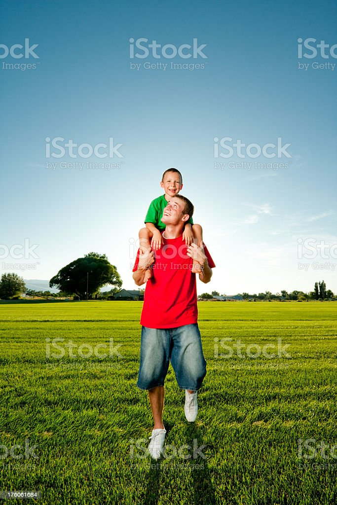 Little Boy Riding Piggy Back royalty-free stock photo