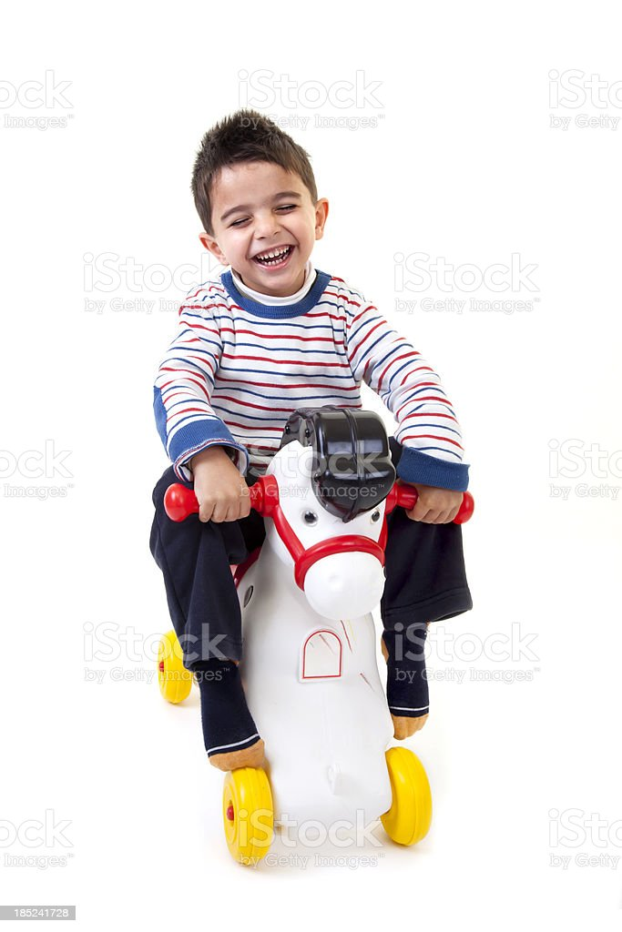 little boy riding plactic horse royalty-free stock photo
