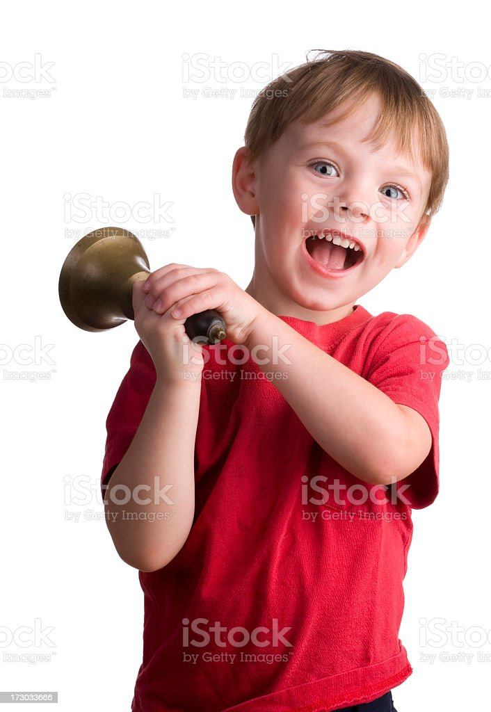 Little boy ringing a bell royalty-free stock photo