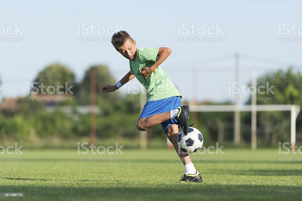 little boy running dribbling royalty-free stock photo