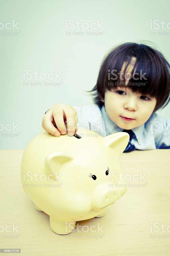 Little boy Saving for a Rainy Day royalty-free stock photo