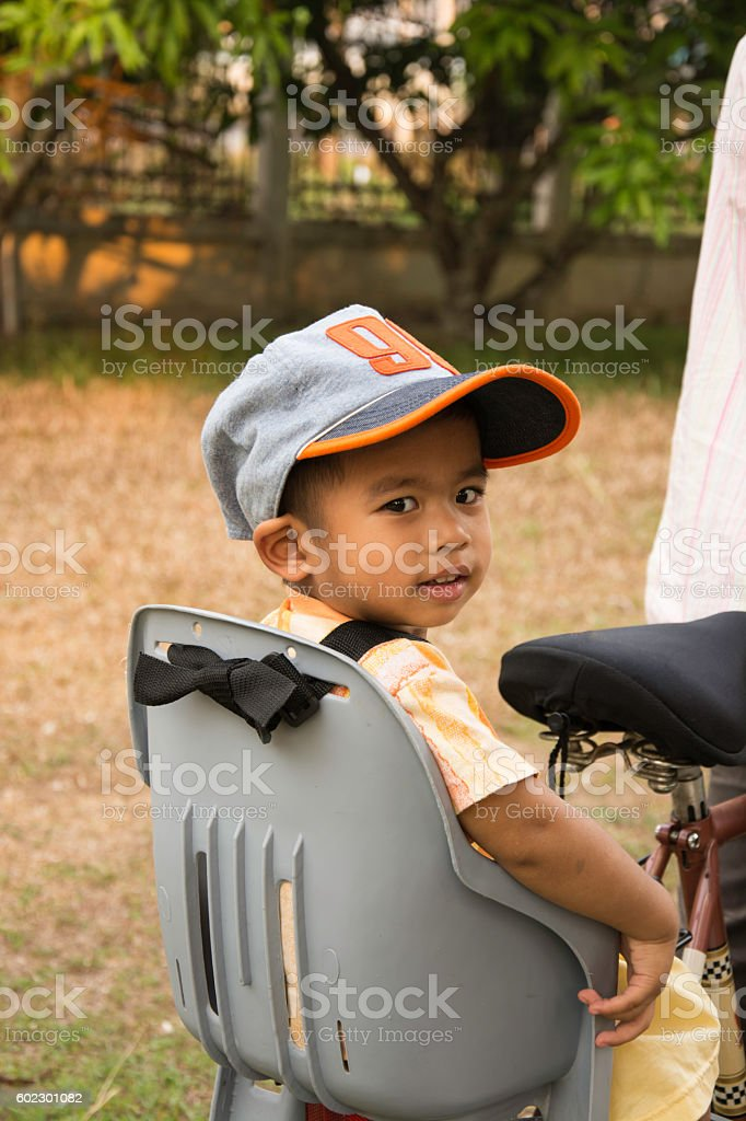 little boy seat bicycle by someone riding on royalty-free stock photo