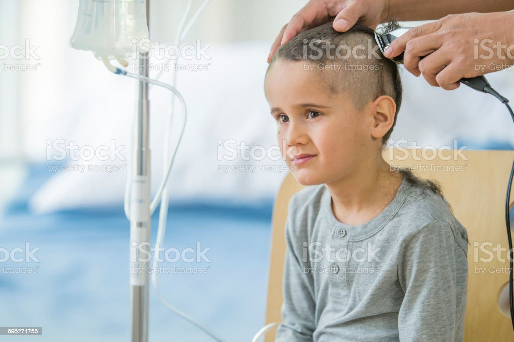 Little Boy Shaves Head for Cancer Treatment stock photo