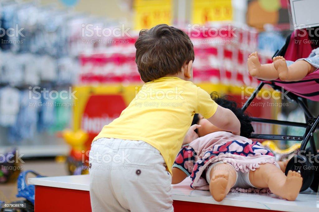 Little Boy Shopper in Supermarket stock photo