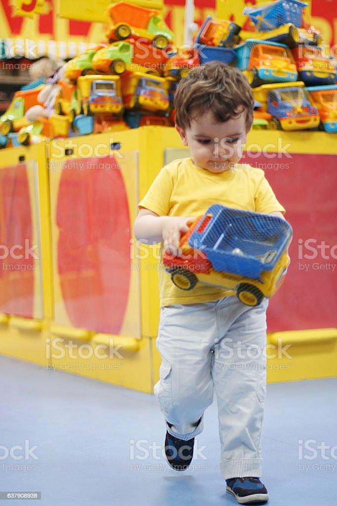 Little Boy Shopper in Toy Store stock photo
