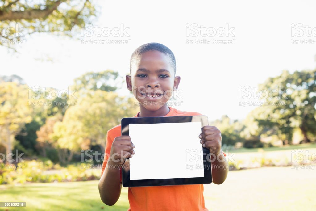 Little boy showing a digital tablet to the camera stock photo