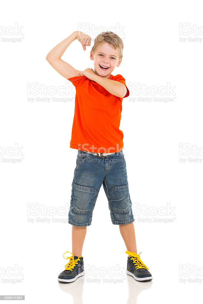 little boy showing off his biceps stock photo