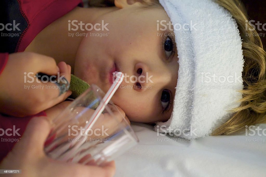 Little Boy Sick In Bed stock photo