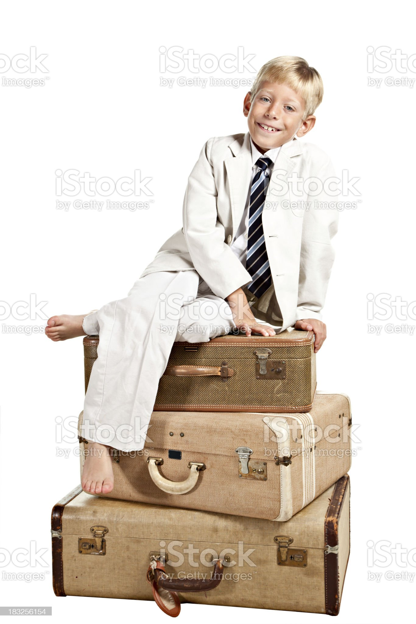 Little Boy Sits On Suitcases Isolated royalty-free stock photo
