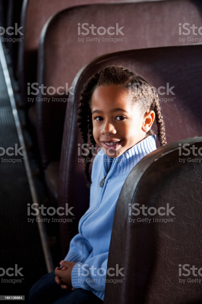 Little boy sitting inside school bus stock photo
