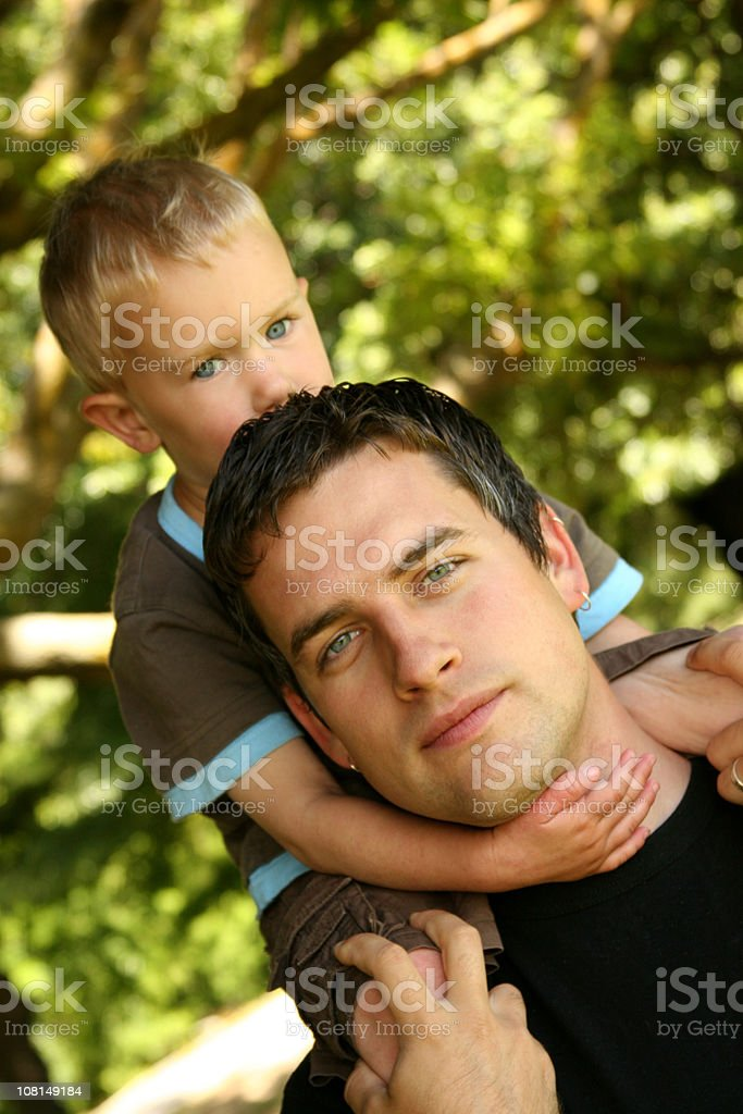 Little Boy Sitting on Father's Shoulders royalty-free stock photo
