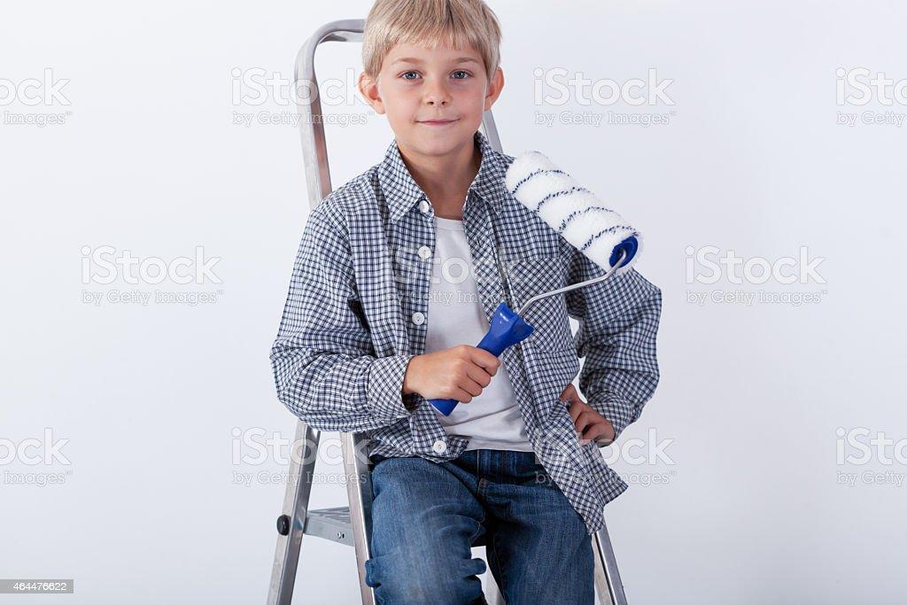 Little boy sitting on ladder stock photo