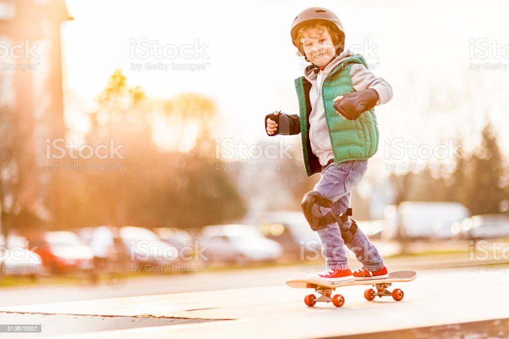 Little boy skateboarding stock photo