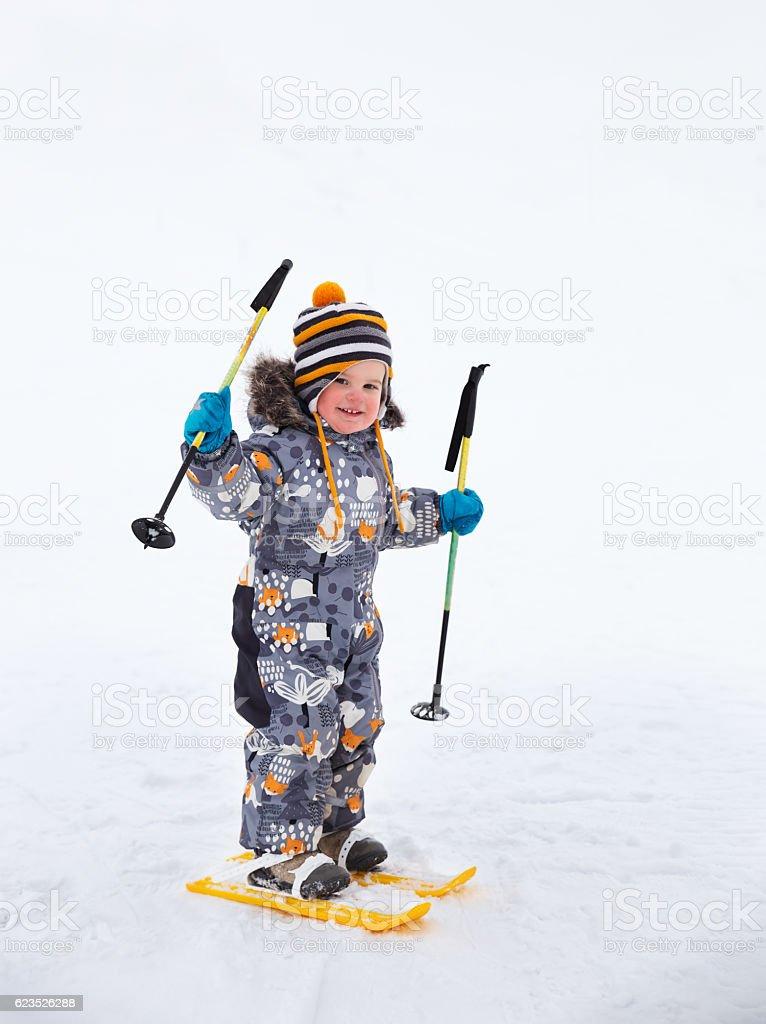 Little boy skiing stock photo
