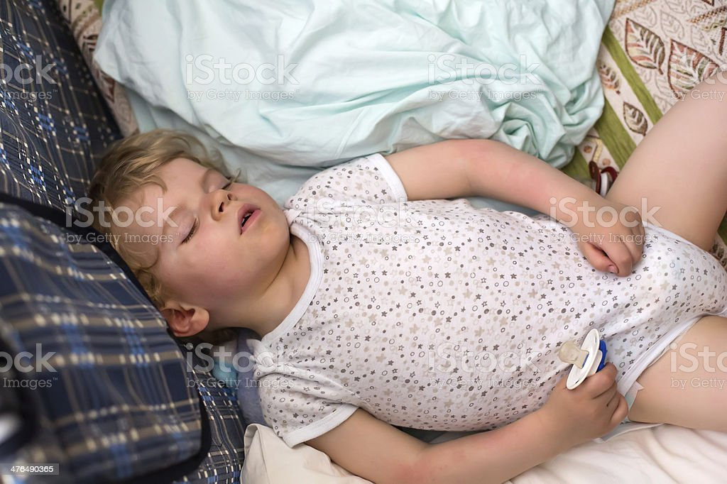 Little boy sleeping in his bed royalty-free stock photo