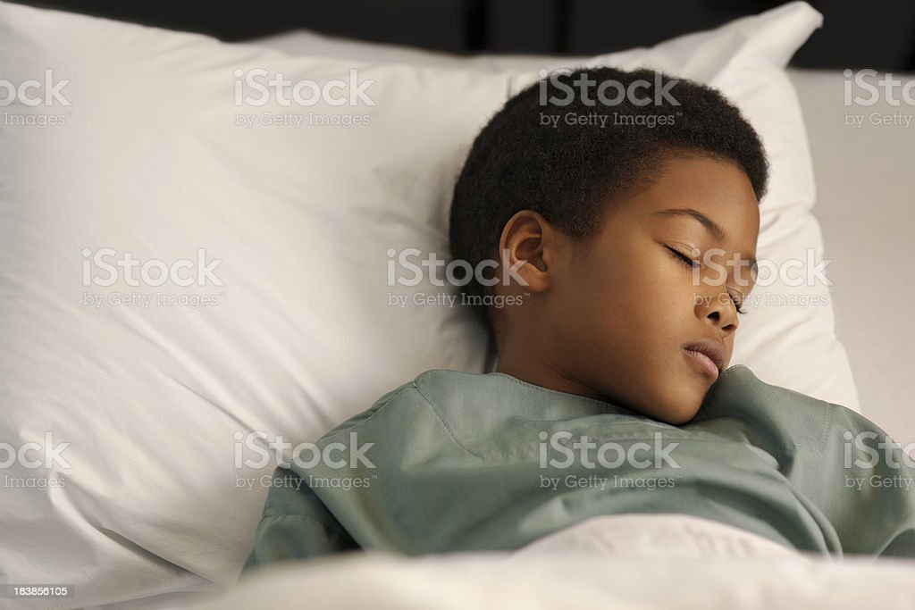 little boy sleeping in the hospital royalty-free stock photo