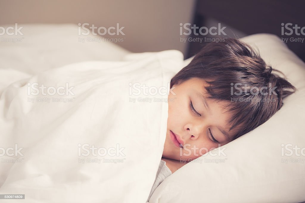 little boy sleeping stock photo