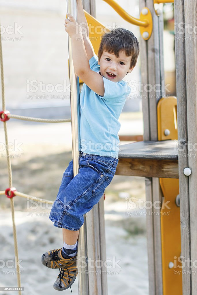 Little boy slide down on pole royalty-free stock photo