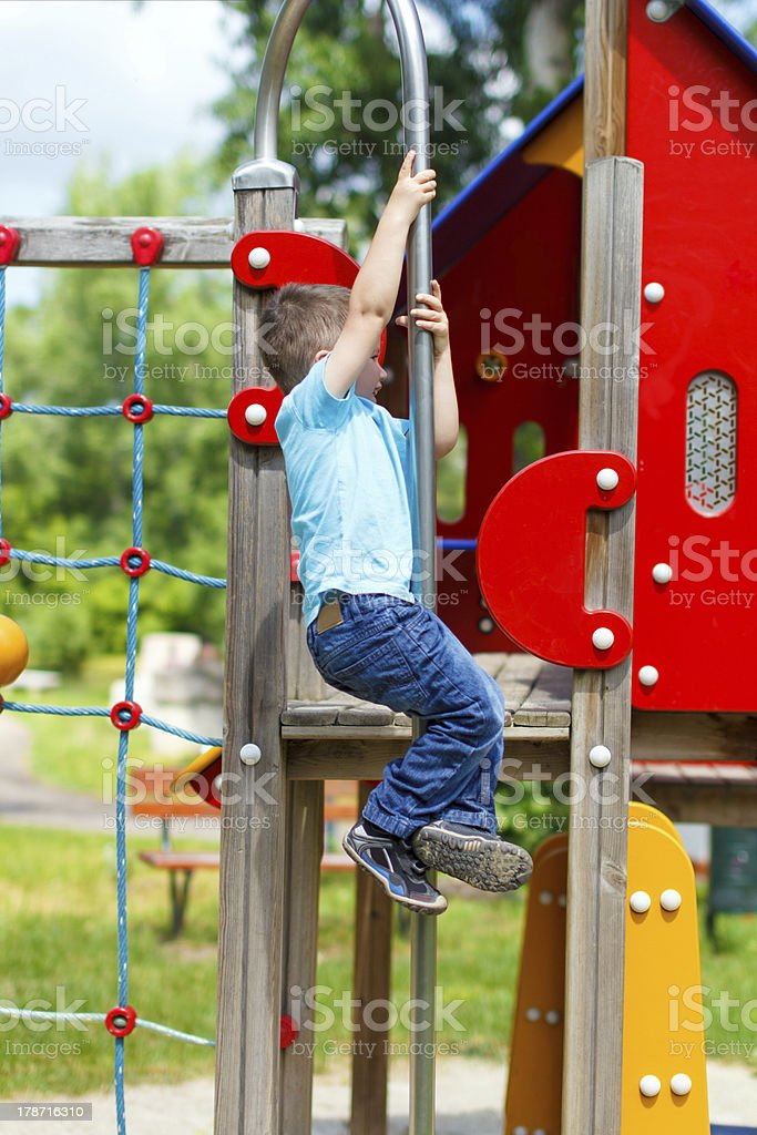 Little boy slip down on the pole at playground royalty-free stock photo
