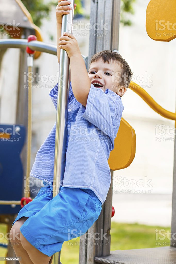 Little boy slip on pole at jungle gym royalty-free stock photo