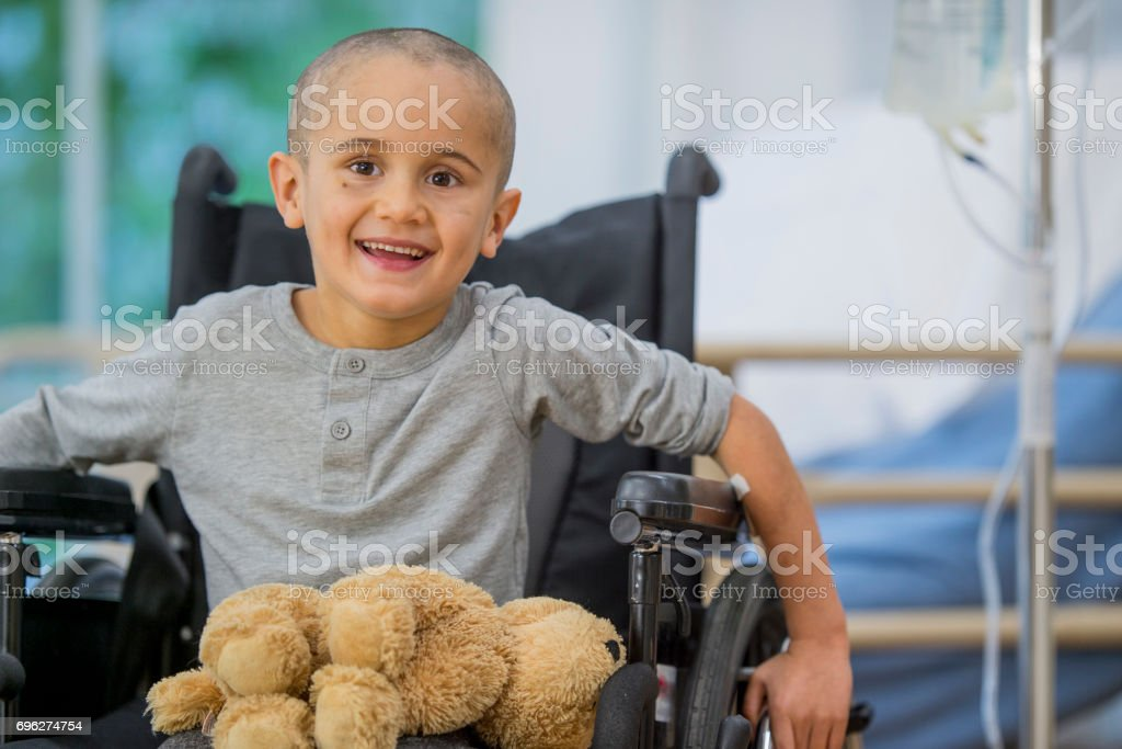 Little Boy Smiles and Learns to Move Again stock photo